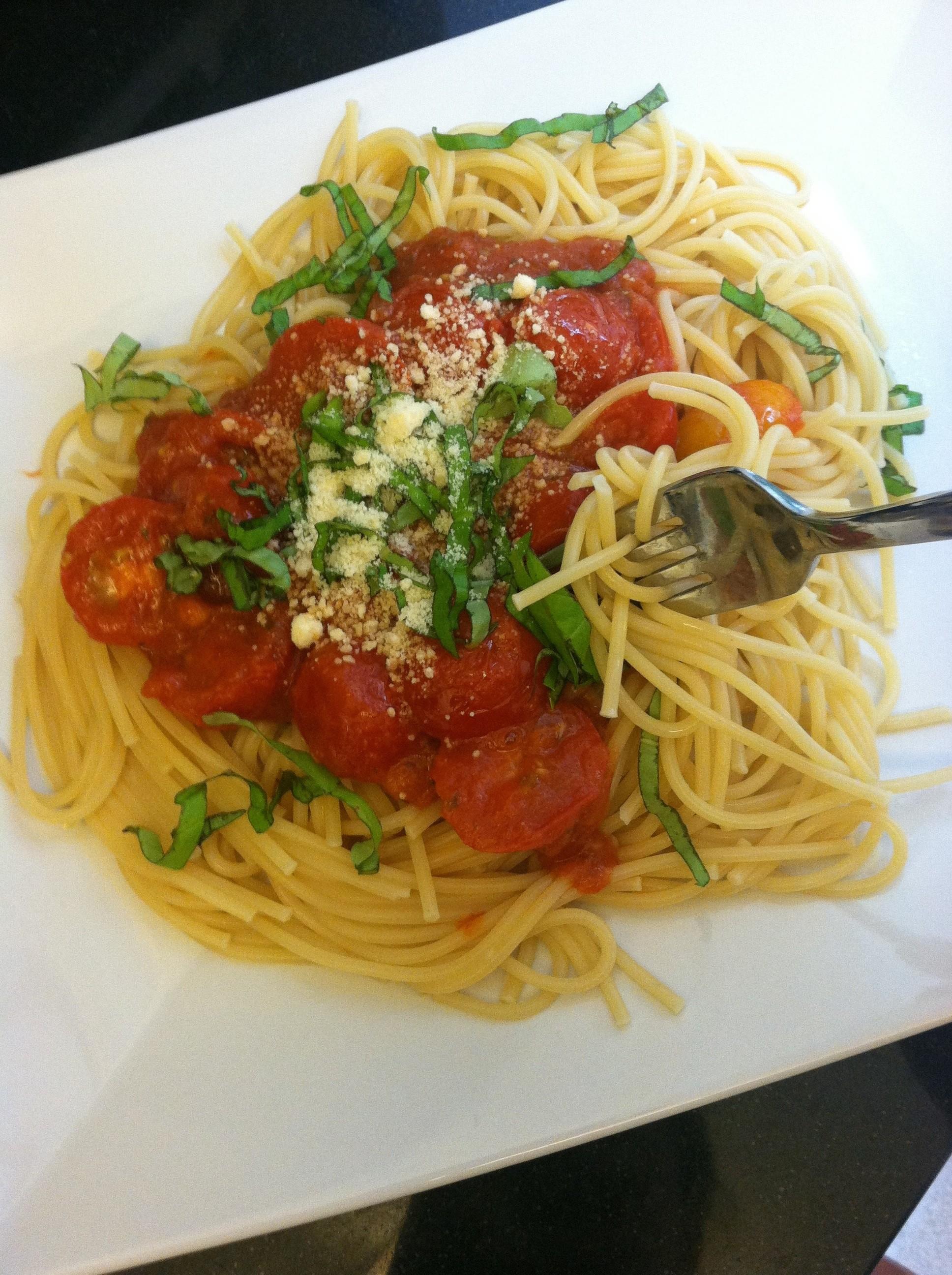 Italian pasta dinner with spiced up sauce gild garnish for Italian dinner